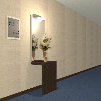 エレベーターホールの案内板と花台。 殺風景だった通路に彩を。